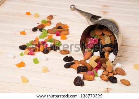 Dried fruits on a wooden surface - stock photo