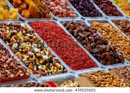 Dried fruits on display on a market - stock photo