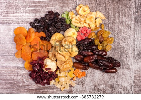 Dried fruits on vintage wooden background