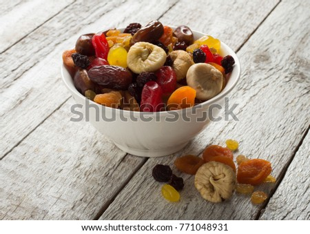Dried fruits on wooden background