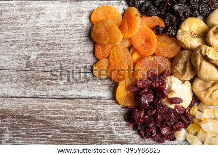 Dried fruits on wooden background in studio photo