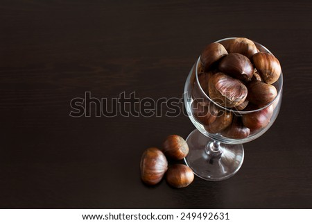 Dried fruits such as chestnuts in glass bowl