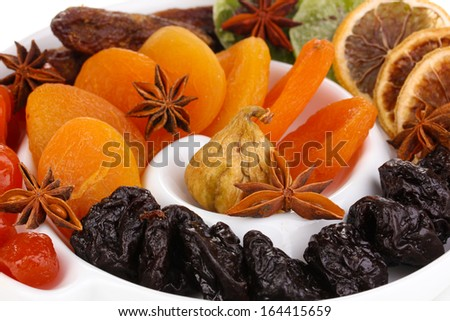Dried fruits with anise stars on plate close-up - stock photo