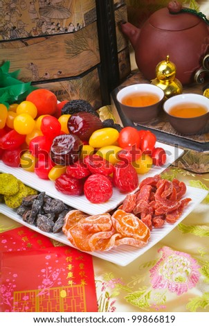 Dried fruits with chinese new year background - stock photo