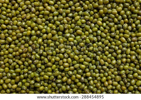 Dried green mung beans as an abstract background texture - stock photo