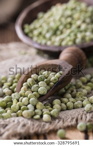 Dried green Peas (close-up shot) on wooden background