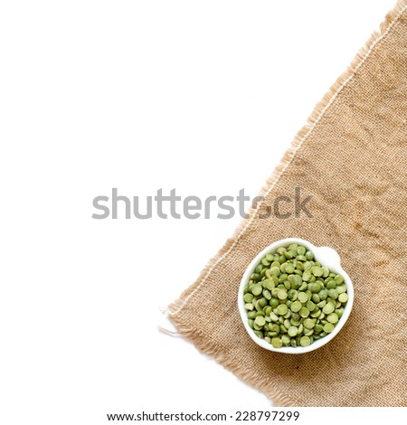 Dried  Green Split Peas in a bowl isolated on white - stock photo