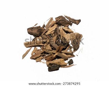 Dried herb, Ebony barks, chopped in small piece, on white background. - stock photo