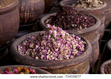dried herbs flowers (rose) in the  Marrakesh street shop, shallow dof - stock photo