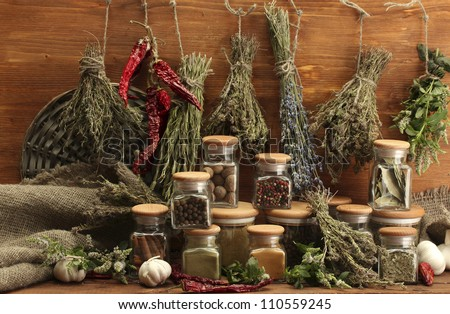 dried herbs, spices and and pepper, on wooden background - stock photo