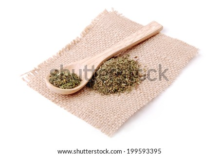 Dried herbs spices on a linen napkin - stock photo