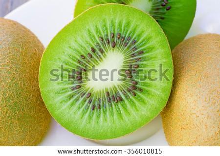 Dried kiwi in white dish,macro - stock photo