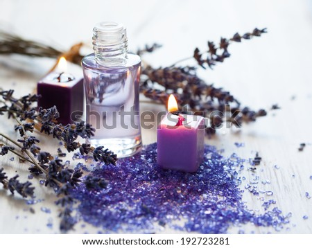Dried lavender flowers with a bottle of essential oil - stock photo