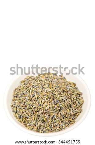 Dried lavender herbal tea in white bowl over white background