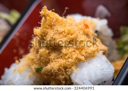 dried meat floss sushi with vegetable in the lunch box - stock photo