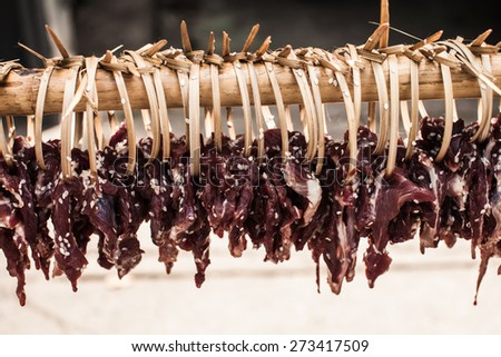 Dried meat on the wooden row