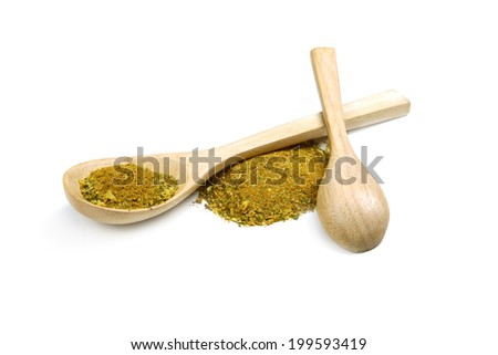 Dried milled spices with turmeric in a wooden spoon - stock photo
