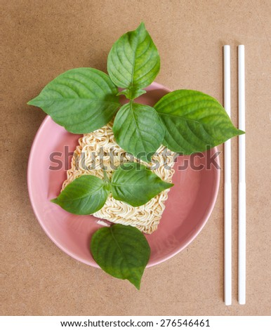 Dried noodle and vegetable in ceramic bowl. - stock photo