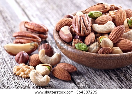 Dried nuts on a wooden background - stock photo