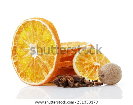 dried orange slices with anise star, nutmeg and cloves, isolated on white - stock photo