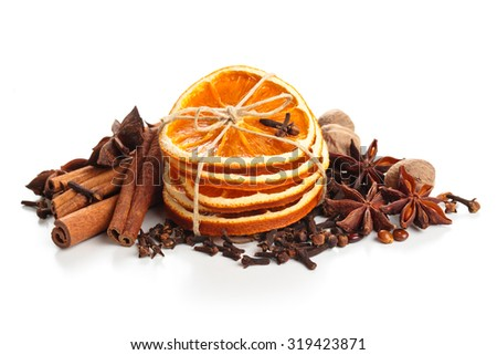 Dried orange, stars anise and cinnamon sticks  isolated on white background. - stock photo