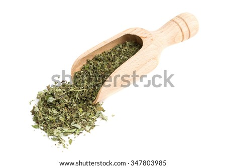 Dried oregano leaves on wooden scoop over white background - stock photo