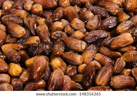 Dried organic date fruits background - stock photo