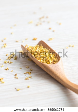 Dried Osmanthus flower tea isolated on the white background - stock photo