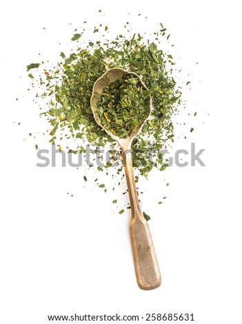 dried parsley in a spoon isolated on a white background - stock photo