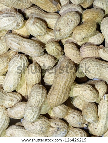 dried peanuts in a pile ready to be peeled and eaten