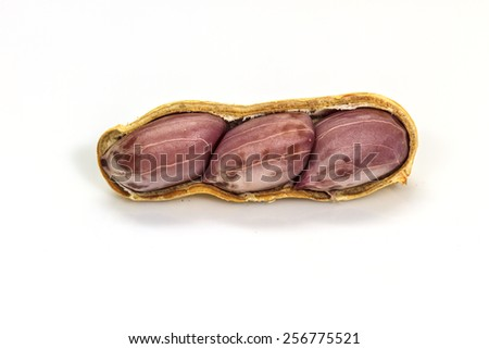 Dried peanuts in closeup on white background