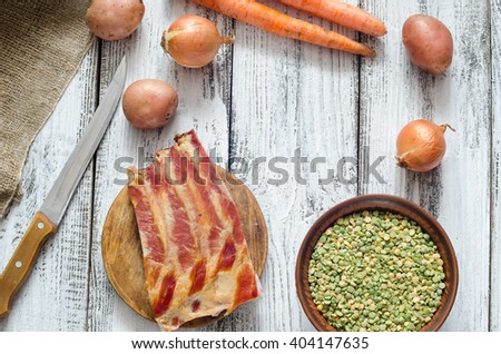 Dried peas and assorted ingredients for pea soup recipe - stock photo