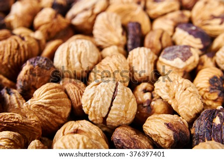 Dried peeled chestnut background - stock photo