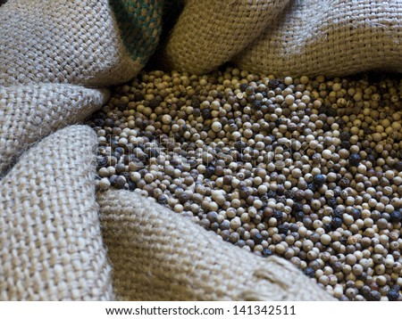 Dried peppercorns in a jute bag