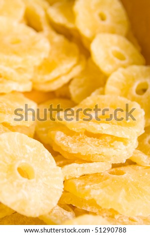 Dried pineapple (ananas) slices in the candy shop. - stock photo