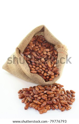 dried pinto beans in a jute sack