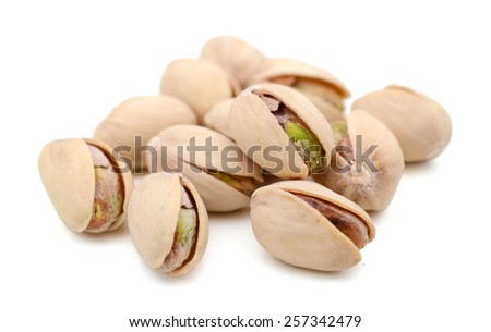 dried pistachio nuts on white background - stock photo