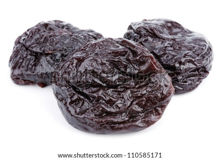 Dried plum fruits - prunes isolated on white background - stock photo
