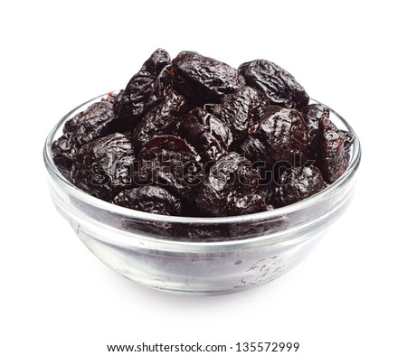 Dried plum in a glass bowl on a white background
