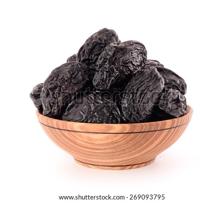 Dried plums prunes on white background. - stock photo