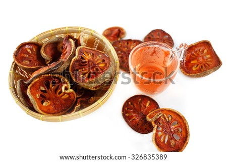 Dried quince and Quince water in glass on wooden table,Healthy  - stock photo