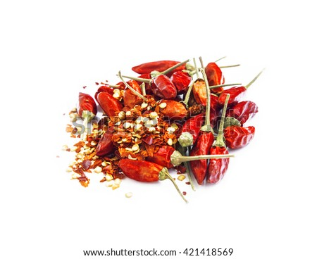 Dried red chili peppers and chili flakes isolated - stock photo