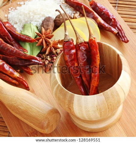 Dried Red Chili Peppers and other Assorted Spices used in Asian Cooking - stock photo