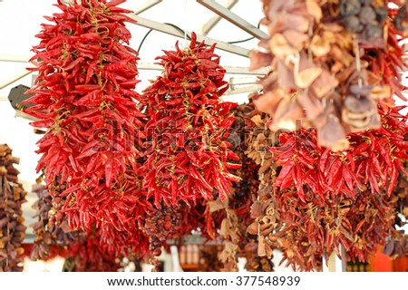 dried red chillies hanging on a market place - stock photo