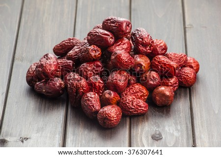 Dried red date or Chinese jujube. Traditional herbal medicine spill on mat. - stock photo