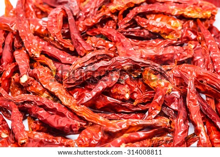 Dried red hot peppers isolated on white background - stock photo
