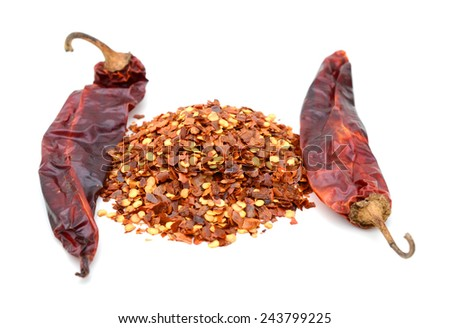 Dried red peppers and flakes, isolated on white. - stock photo