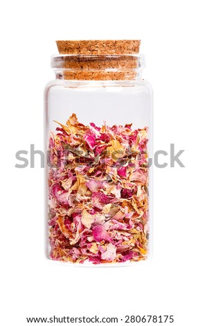 Dried rose petals in a bottle with cork stopper for medical use. - stock photo