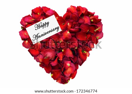 Dried Rose Petals In A Heart Shape With Card Saying Happy Anniversary