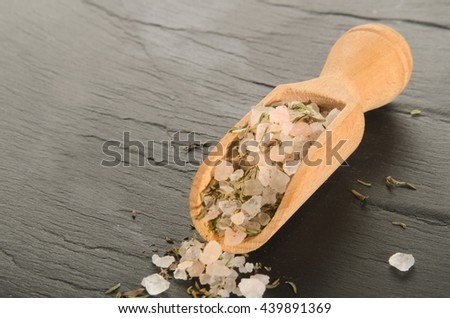 dried salt mixture with crushed thyme - stock photo